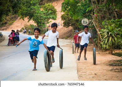 PALAWAN, PHILIPPINES-MARCH 28, 2016: Kids are playing with used tire in remote village on March 28, 2016, at Palawan, Philippines.