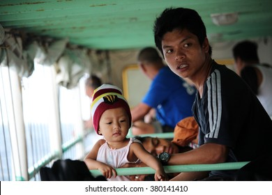 PALAWAN/PHILIPPINES - CIRCA DECEMBER 2015: A father and a child on a ferry travel between El Nido and Coron