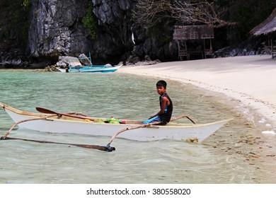 PALAWAN/PHILIPPINES - CIRCA DECEMBER 2015: Local boy on a typical filipino boat called balangay on one of the islands of Coron archipelago