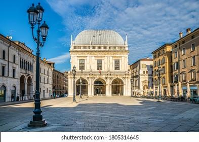 Palazzo della Loggia palace Town Hall Renaissance style building and street lights in Piazza della Loggia Square, Brescia city historical centre, blue sky background, Lombardy, Northern Italy