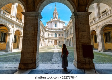 Palazzo della Sapienza in Rome, Italy. Young nice woman tourist in the former Roman University. It is a landmark of Rome. Italian and European historical architecture and culture. Travel across Rome.