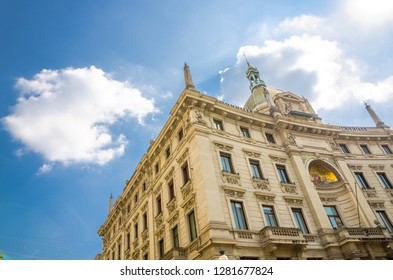Palazzo delle Assicurazioni Palace Generali building on Piazza Cordusio square in historical city centre with blue sky background, Milan, Lombardy, Italy