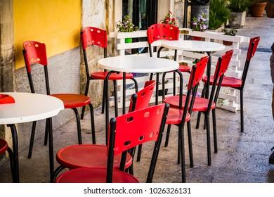 Palazzolo Acreide outdoor restaurant waiting customers.