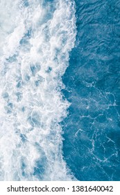 Pale blue sea wave during high summer tide, abstract ocean background