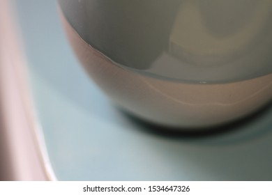 Pale green ceramics earthenware details under close up macro lens.