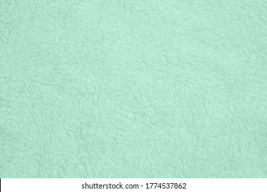 Pale green plush fabric background with copy space for message or use as a texture