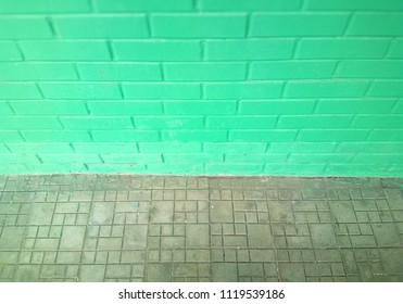 Pale green symmetric street brick wall background