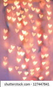 Pale Pink Heart Bokeh on a pale Background