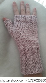 Pale pink knitted fingerless glove.