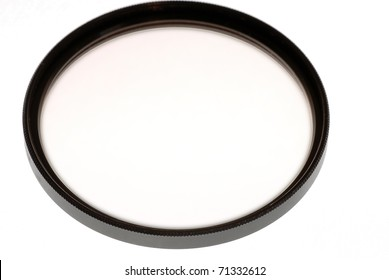 Pale pink Skylight filter used to protect camera lenses from scratches and other damage is isolated on white background.