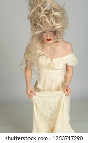 Pale young blonde woman in a yellow dress