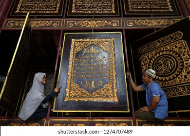 palembang city, south sumatera, indonesia. desember 30, 2018 : the biggest Qur'an in the world, made of wood.