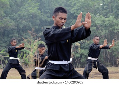 Palembang, South Sumatra, Indonesia - August 06 2019 : Silat PSHT martial art students are being tested for the level of courage test