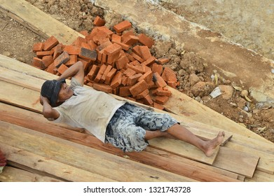 Palembang, South Sumatra, Indonesia - February 16 2019 : The workers of puncak mas lampung are taking rest