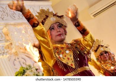 Palembang/Indonesia, August 14, 2019 : Siwa wax dance custom clothing from Palembang (tari lilin siwa) with slow speed technic photography
