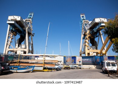 Palermo, Italy, April 24, 2018: Cranes in Palermo harbour on a sunny day.