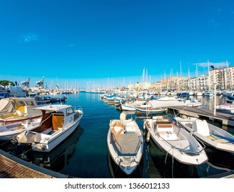 PALERMO, ITALY - CIRCA JUNE 2018: View on Boats and yachts as they park in La Cala bay, the old port in the historic centre of the city circa June 2018 in Palermo, Italy.