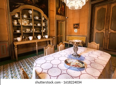 PALERMO, ITALY: Dinning room with antique utensils and furniture, interiors of Palazzo Alliata di Villafranca, a Baroque aristocratic home on 10 October 2019. Giuseppe Garibaldi lived in house in 1860
