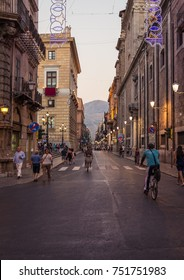 PALERMO, ITALY - JULY 12, 2017: Pedestrians walking in Palermo street, in old city centre of Palermo, Italy.