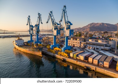 PALERMO, ITALY - JULY 28, 2017: Big port cargo cranes in Palermo, Italy in a beautiful summer day