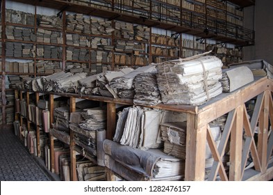 PALERMO, ITALY - JUNE 16, 2018:  Bundles of old papers and files stacked on shelves belonging to the State Archives of Palermo, Sicily.  Papers dating back hundreds of years are kept here