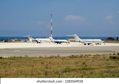 PALERMO, ITALY - JUNE 21, 2018:  Private jet planes parked at Palermo international airport on a sunny summer day.