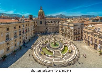 Palermo, Italy - May 17, 2019: View of baroque Piazza Pretoria and the Praetorian Fountain in Palermo, Sicily, Italy.