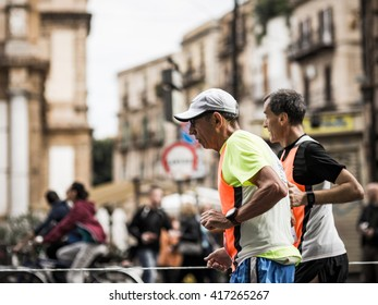PALERMO, ITALY - NOVEMBER 10 2015: Scene from the Marathon in Palermo on a warm November morning. People running in the old town of the Sicilian Capital of Italy