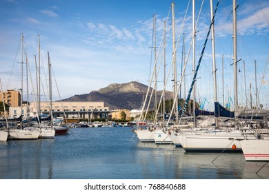 PALERMO, ITALY - NOVEMBER 29, 2017: Boats and yachts parked in La Cala bay, old port in Palermo, Sicily, Italy.