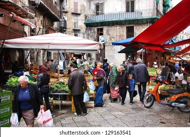 PALERMO, ITALY - OCTOBER 24: People shop at local market on October 24, 2009 in Palermo, Italy. Palermo is the 5th most populated area in Italy and the most populated on the island of Sicily.