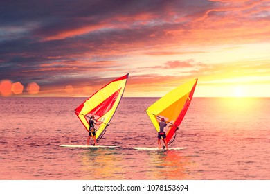 Palermo, Italy, October 31, 2017: Windsurfers catch wind in the sea at sunset