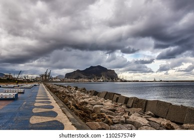 Palermo sea port with cloudy sky, seafront view at Monte Pellegrino Mount. Sicily Italy