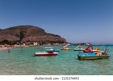 Palermo, SICILY - 01.06.2018: Mondello white sand beach in Palermo. People on beautiful beach at the bay in Palermo, Popular touristic beach in Sicily.