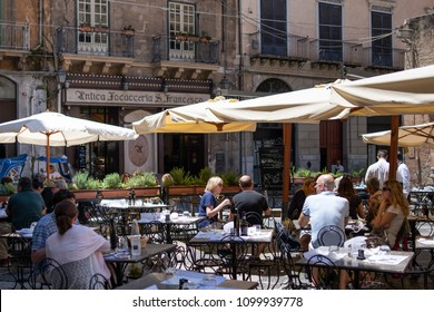 Palermo, Sicily, Italy - May 25, 2018: people dining outdoor on a sunny day at Antica Focacceria San Francesco, one of the most famous  and oldest restaurants in the city.