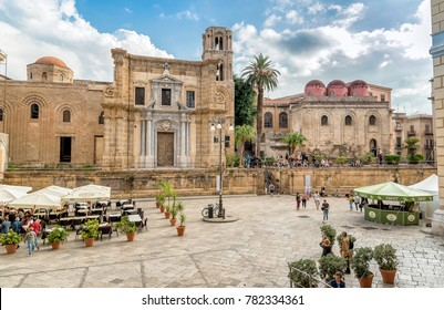 Palermo, Sicily, Italy - October 5, 2017: View of Bellini Square with tourists visiting the Santa Maria dell'Ammiraglio Church known as Martorana Church and San Cataldo church in the center of Palermo