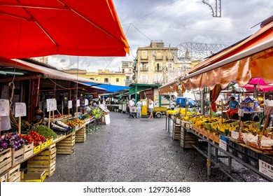 PALERMO, SICILY, ITALY - SEPTEMBER 28, 2018: A lot kind of Vegetables and fruit for sale at Palermo street market. In Palermo is a very popular street markets.