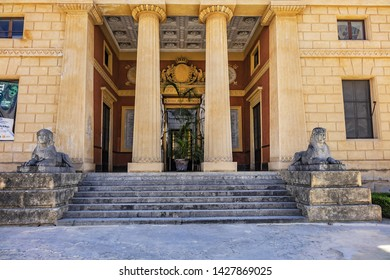 PALERMO, SICILY, ITALY - SEPTEMBER 30, 2018: Neoclassical style Gymnasium (1789) - main building of Palermo Botanical Garden (Orto Botanico di Palermo) - institution part of Palermo University.