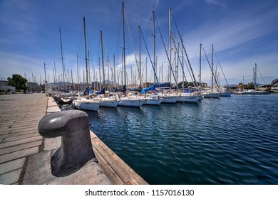 Palermo, Sicily - June 6, 2018: Boats and yachts in the bay of Palermo, Sicily with large mooring bollard in the foreground. Editorial only.