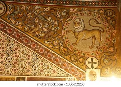 PALERMO, SICILY - NOV 28, 2018 - Lion mosaic on wall of the Capella Palatina, Palermo, Sicily, Italy