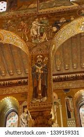 PALERMO, SICILY - NOV 28, 2018 - Mosaic of St Cataldus, bishop of Taranto,  on a column of the Capella Palatina, Palermo, Sicily, Italy