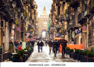 Palermo, Sicily/Italy - February 20 2018: Rainy Days in Palermo. People walking through the inner city of Palermo
