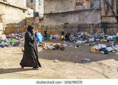palestianans searching food in the dumb in Sabra and shatila refugee camp in beirut Lebanon 3 February 2018