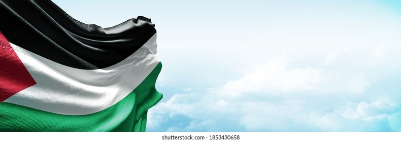 Palestine flag in the blue sky. Horizontal panoramic banner.