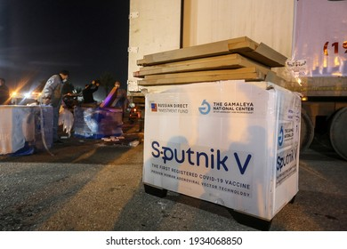 Palestinian healthcare staff unload boxes of the Russian-made Sputnik V coronavirus vaccine provided by the U.A.E from a truck arriving from Egypt via the Rafah crossing in Gaza Strip, on Mar 11, 2021