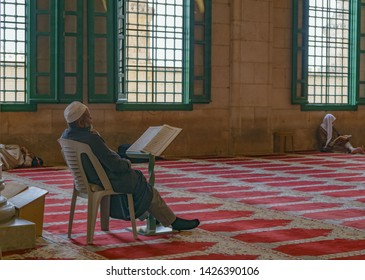 Palestinian muslim reading qoran in the Al Aqsa Mosque at Aqsa Complex near the dome of the rock in the Old City of Jerusalem in israel palestine 22 october 2018