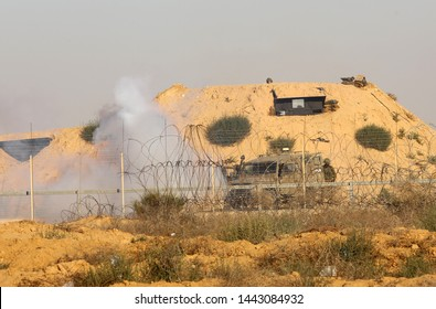 Palestinian protesters clash with Israeli security forces during a protest on the Israel-Gaza border, in east of Rafah, in the southern Gaza Strip, on July 5, 2019. Photo by Abed Rahim Khatib