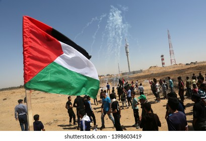 "Palestinian protesters clash with Israeli troops during a protest marking the 71st anniversary of the ""Nakba"" on the Israel-Gaza border, east of Gaza Strip, on May 15, 2019. Photo by Abed Rahim Khatib"