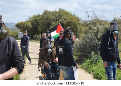 Palestinian protesters gather at the beginning of the Friday protests, Bilin, Palestine. 20/03/15