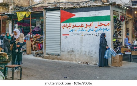 Palestinian woman standing near the Palestine flag in Sabra and shatila refugee camp in beirut Lebanon 3 February 2018