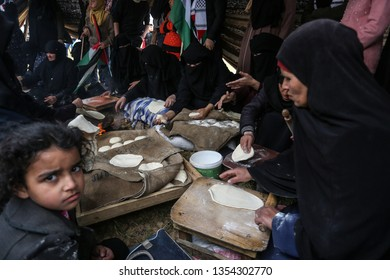 "Palestinian women bake ""traditional"" bread ""Great March of Return"" and ""Palestinian Land Day"" near the border between Israel-Gaza, at east the Gaza Strip, on March 30, 2019. Photo by Abed Rahim Khatib"